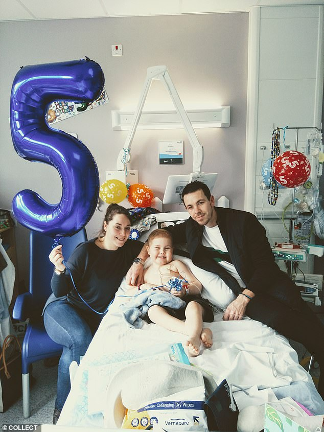 Oscar's parents Olivia and Jamie (pictured celebrating their son's fifth birthday last month in hospital) announced on Facebook today they have 'the best news! Oscar has a match!!!'