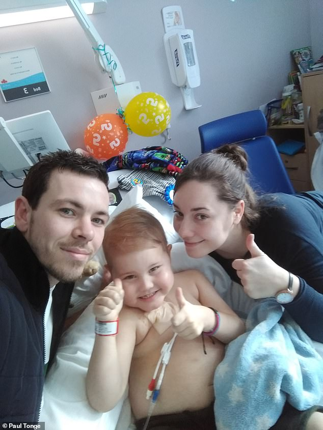 The youngster - pictured in hospital with his parents - was forced to endure four rounds of chemotherapy after the first three cycles had no effect. His cancerous cells are now reducing, putting Oscar in a better position to receive a stem-cell transplant