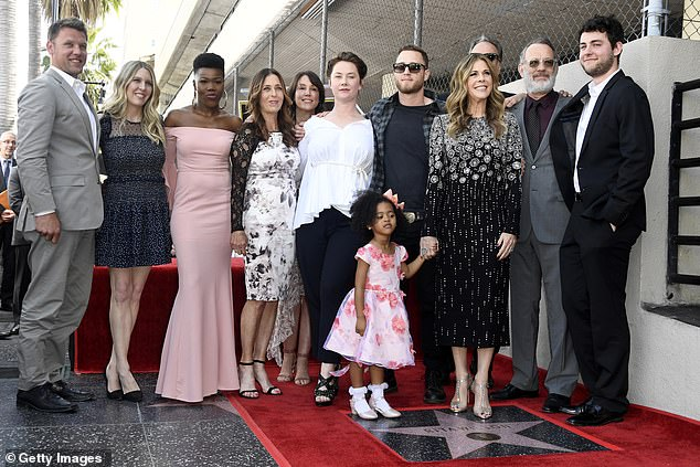 A very big family: Rita stood next to her star, along with Tom, Truman Hanks and Chet Hanks as well as other family members like Tom's daughterElizabeth Ann Hanks (in the white dress)