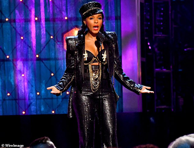 Honored: JanelleMonáe wore a glittering black suit and an assault rifle-decorated bra to induct Janet Jackson. 'I'm here tonight to induct the legendary queen of Black Girl Magic into the Rock and Roll Hall of Fame,' she said