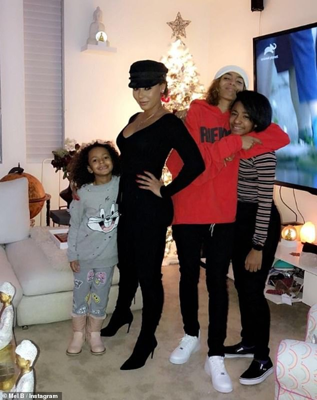 Happy family: Mel is the mother of three daughters - Madison with Stephen Belafonte, Angel, 11, with Eddie Murphy, and Phoenix, 20, with Jimmy Gulzar
