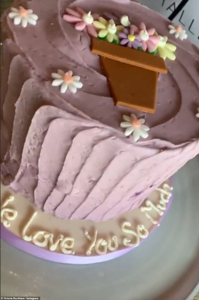 Scrumptious: Victoria's four children also presented her with a beautiful pink frosted cake with the words'we love you so much' emblazoned on the icing