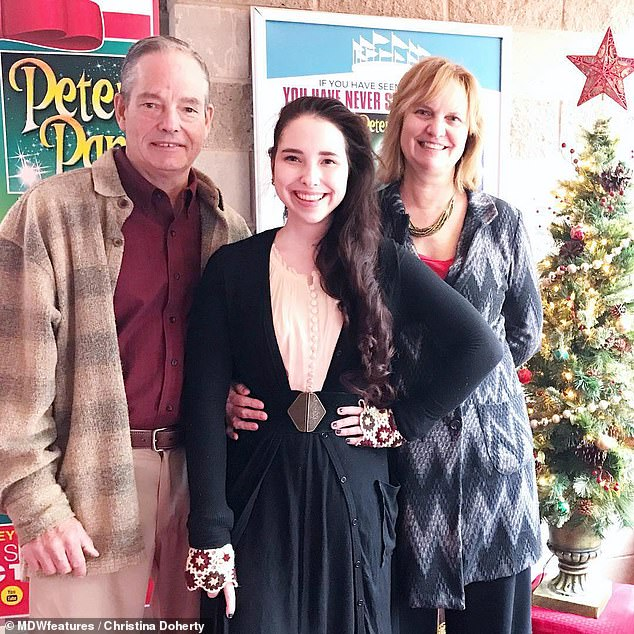 Christina Doherty, 23, from Woburn, Massachusetts, self-diagnosed a genetic condition, Ehlers-Danlos syndrome (EDS). Pictured with her parents