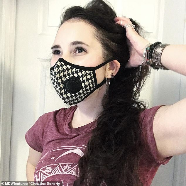 Miss Doherty takes 30-40 tablets a day and has daily rehab exercises and nebuliser treatments to help her breathe. Pictured, wearing a mask because she is sensitive to smells