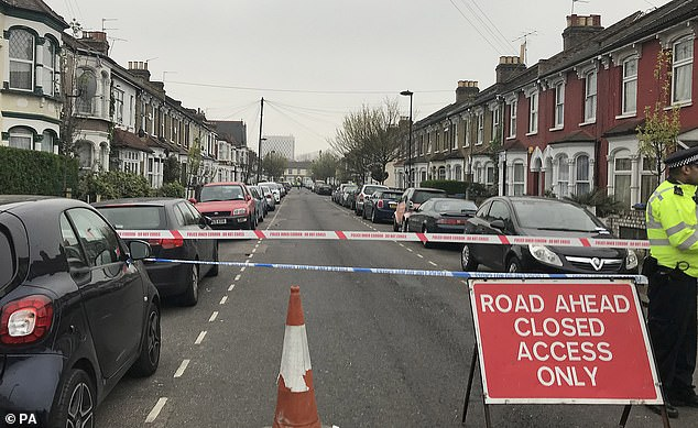 Kakaire, who had a history of carrying blades, later told a psychiatrist at maximum security Broadmoor Hospital that he had been hearing voices 'that were going to kill him'. Pictured: The scene in Fairfield Road, Edmonton, after the fifth attack