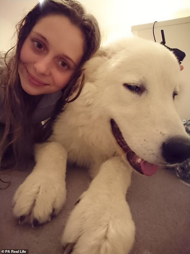 Miss Gamber's life has been turned around by her dog, nine-month-old Bo, who has comforted her through her darkest times with pain that feels like 'being stabbed with a knife'