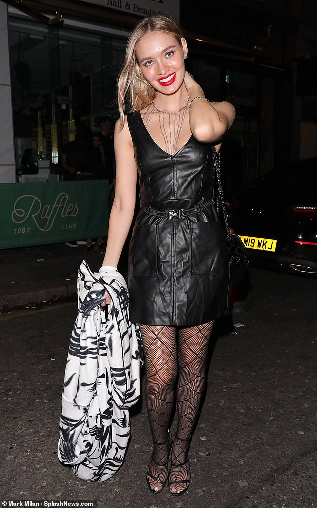 Outfit: Model Roxy Horner wore a black leather mini-dress with a v-neckline and patterned tights