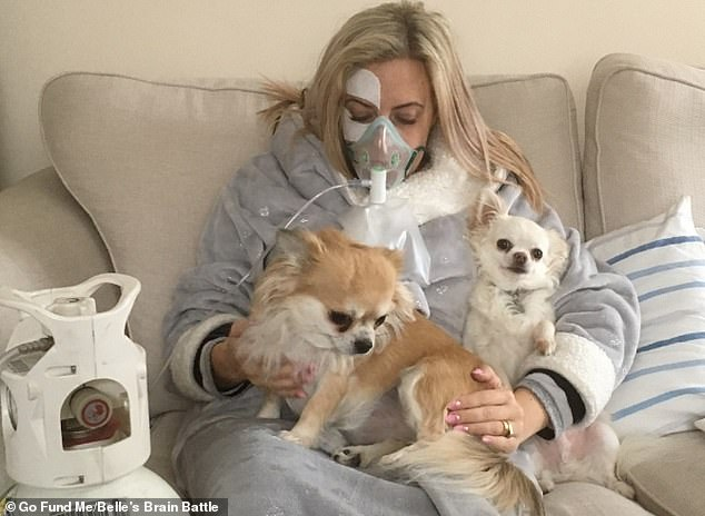 Annabelle Woods, 35, has suffered from nerve pain, migraines and paralysis in her face since she fell through a trap door at work 14 years ago (pictured at home having oxygen therapy, which can be used to treat nerve damage)