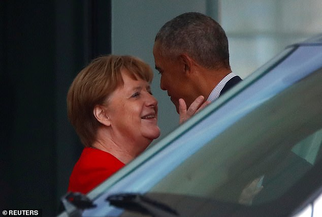 Angela Merkel says goodbye to Barack Obama at the German chancellery in Berlin today