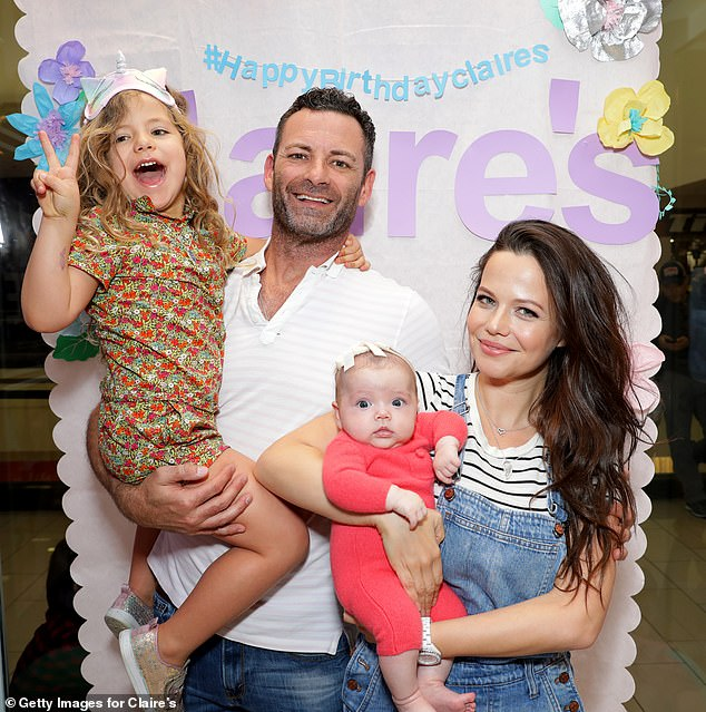 'I didn't know how long it was in there': Australian actress Tammin Sursok candidly shares moment she discovered baby vomit in her hair (Pictured: Tammin with husbandSean McEwen, and daughters Phoenix, five, and newborn Lennon)
