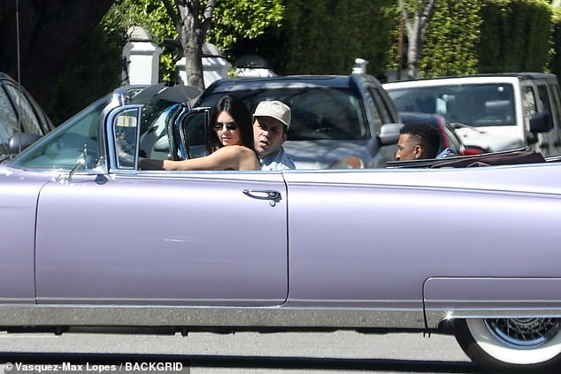 Riding in cars with boys: She took a spin around the neighborhood with her guy pals
