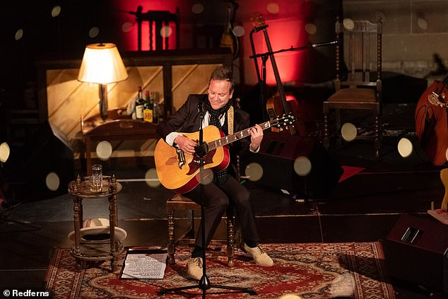 Music: The actor, 52, arrived on stage with a guitar and was joined by two other musicians for the performance