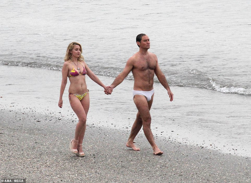 Stunner:The 46-year-old displayed his incredible frame in a pair of barely-there white swimming trunks while strutting along the beach hand-in-hand with his bikini-clad co-star Ludivine Sagnier, who plays Esther in the show
