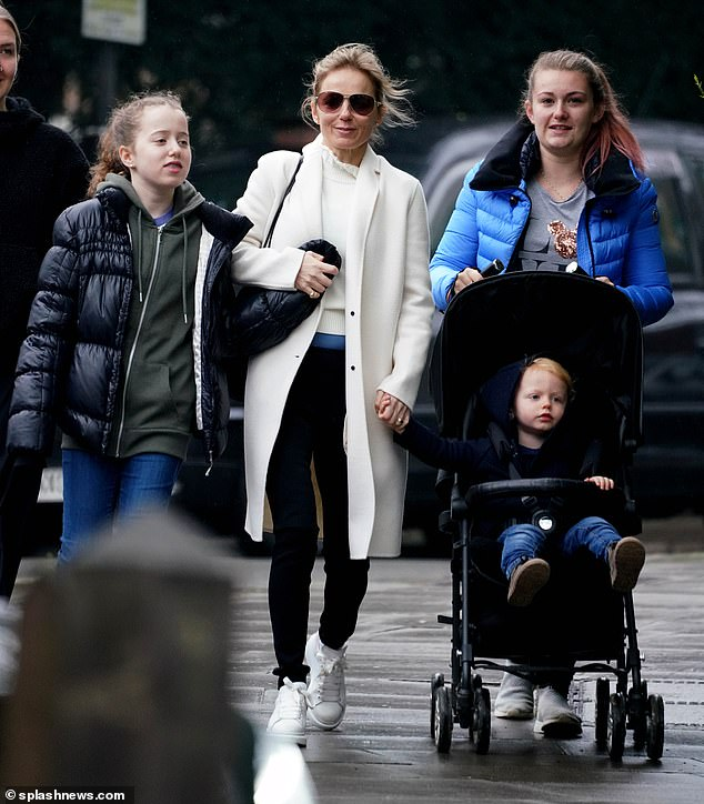 Family: Geri Horner shook off the drama while enjoying a joyful family outing with his son Monty and daughter Bluebell in London on Tuesday