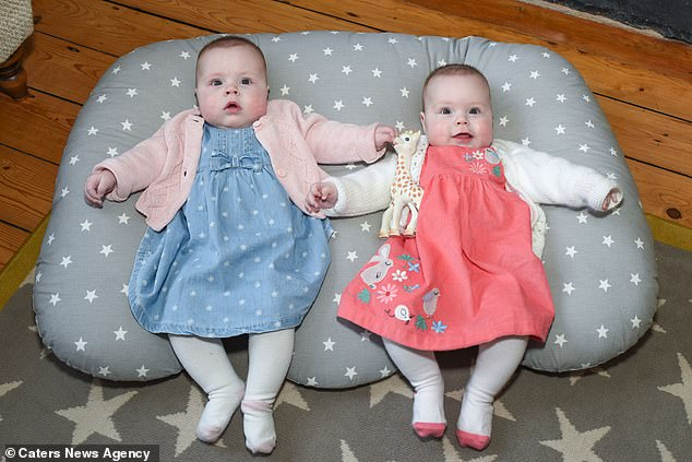 The girls are now healthy eight-month-old babies, despite doctor's fears they could be brain damaged, but do need physiotherapy