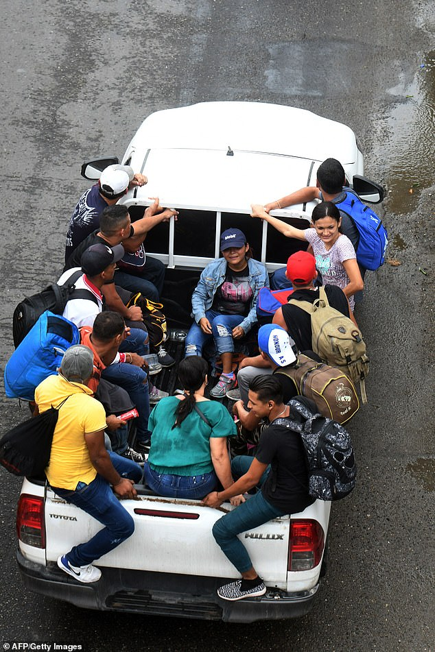 Others crammed into the back of pick-up trucks as they left the Metropolitan Center of San Pedro Sula