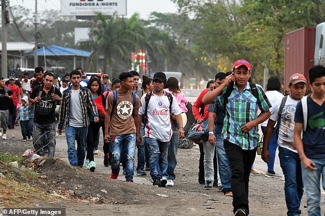 More of the congregation left on Wednesday morning and were pictured walking on foot bound for the Guatemalan border