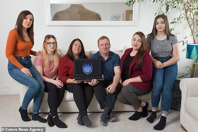 Mrs Lee-Tubby's mass, situated behind her right eye, is now being monitored after she opted to 'watch and wait' (pictured with her daughters and husband, from left to right: Emma, Symone, Elaine, Shawn, Carla and Leah)