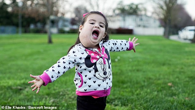 If Olivia can get it, her life could be changed before she grows up to realise she is 'different' from other children, her parents said. Pictured in her home of California