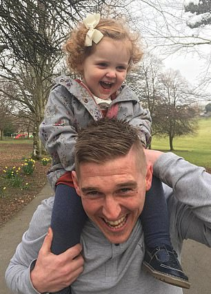 The youngster (pictured with her father) is at school and 'doing really well'