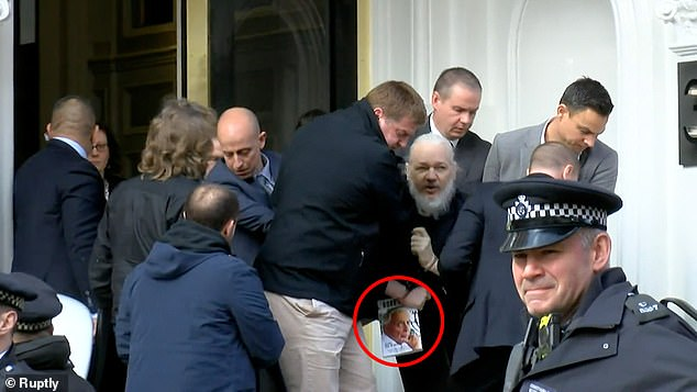 Julian Assange appeared to be sending a message by carrying a book by Gore Vidal on the American security state when he was arrested in London yesterday. The WikiLeaks founder was pictured carrying a copy of 'The History of the National Security State', which is a scathing critique of the American military-industrial-security complex (the book is circled above)