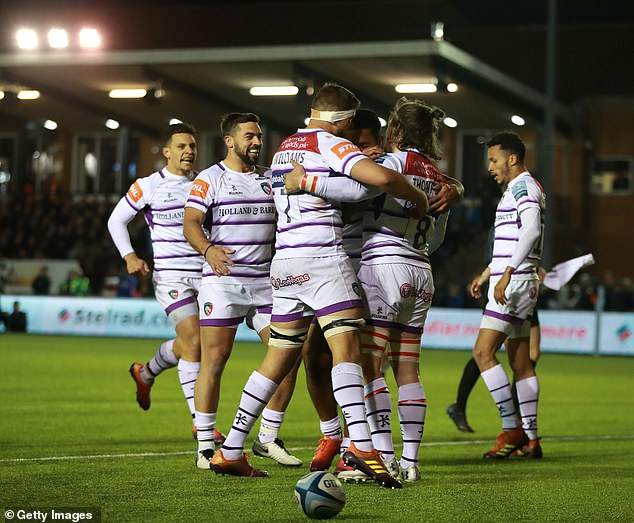 Leicester Tigers celebrate after Thompson scores their second try of the evening