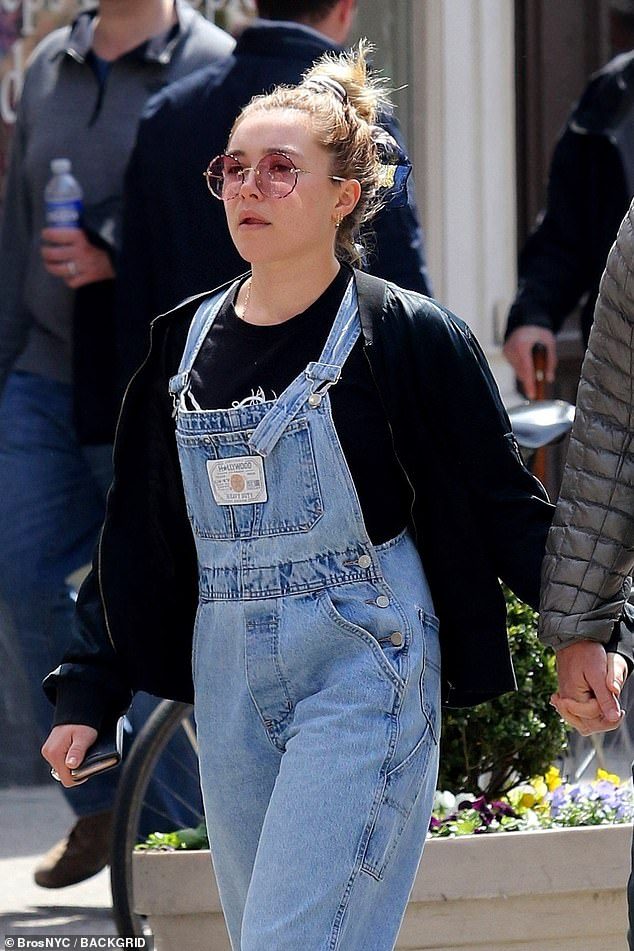 The look:When she was seen out with Zach on Friday, Florence wore a set of denim overalls with a black sweater and a large pair of pink sunglasses
