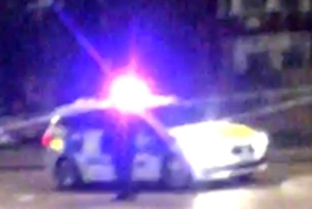 Police, pictured yesterday, at the junction between Nightingale road and Bounds Green road where a 19-year-old boy was stabbed
