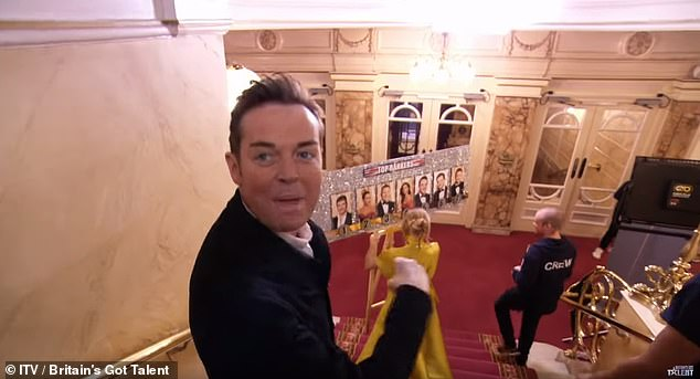 Game face: The judge is seen in the clip playing a game named Top Rankers with funnyman Stephen Mulhern