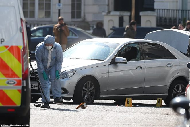 The scene in Holland Park after shots were fired by police near the Ukrainian embassy to stop the silver Mercedes and its driver