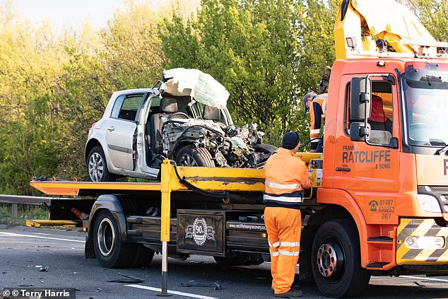 Pictured, a silver car was completely destroyed by the impact of the crash with a pick up truck