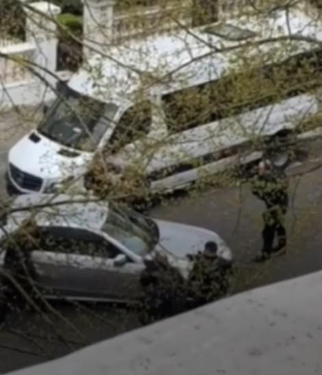 This is the dramatic moment that armed police open fire on the Mercedes which was deliberately rammed into the Ukrainian ambassador's car in London five times. In a video filmed from a nearby building by witness Darcy Mercier, the armed officers can be heard shouting 'open the door now!' at the man, 40, inside the motionless car, before they fire two shots