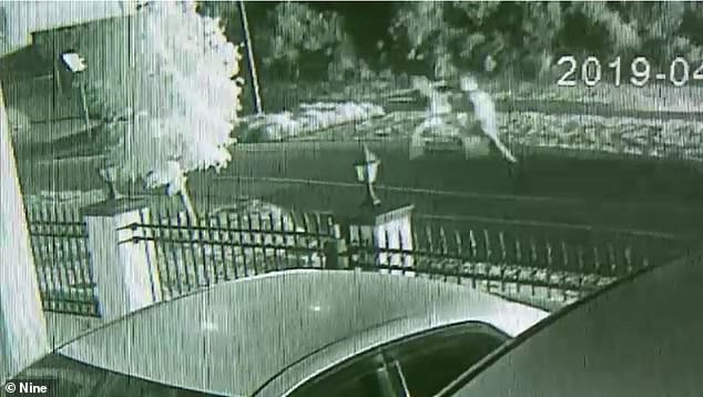 Police are hunting two men (pictured on CCTV) seen running from a burning Porsche used in a drive-by shooting at a nightclub in which a bouncer was killed
