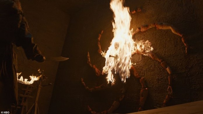 On fire: Edd shows them an undead boy spiked to a wall, which comes screaming back to life before they set it on fire.
