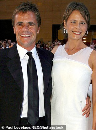 The late financier and Kidman ended their 11-year marriage in 2007 (pictured together in 2003)