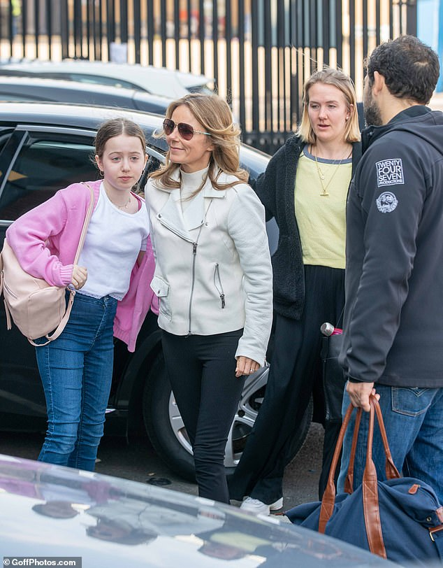Best friend: The singer arrived with her daughter Bluebell, 12, in tow, who sweetly held her hand as she made her way inside