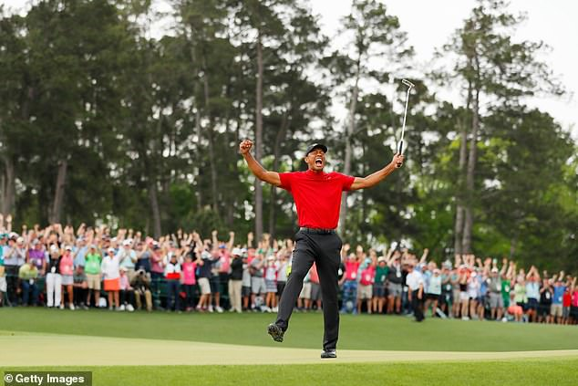 Woods yells out in celebration after sealing an incredible sporting comeback at Augusta