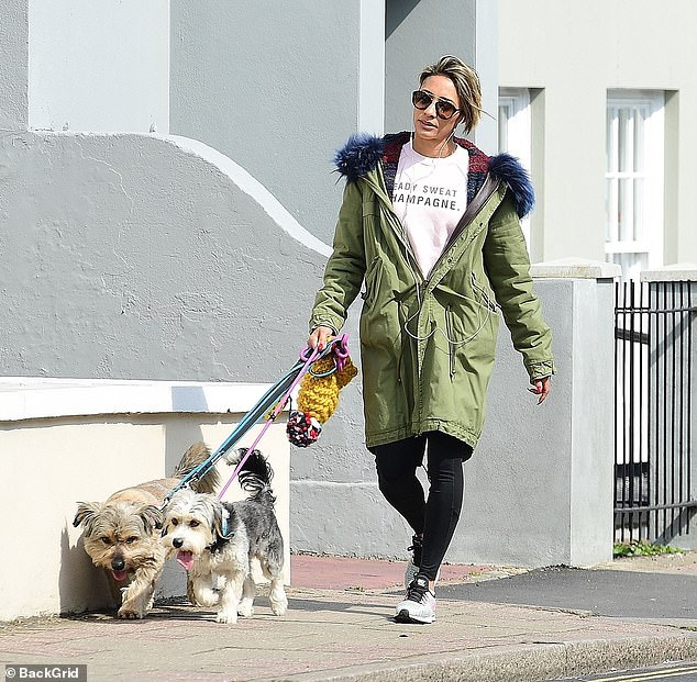 Keeping quiet: Karen Clifton was seen out and about on Sunday, hours after the news of her ex husband Kevin's new romance with his Strictly dance partner was revealed