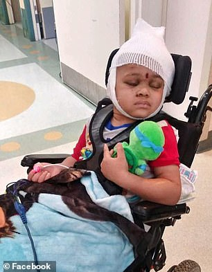Na'vaun is now able to smile, sit up in his wheelchair, hold onto things and kick at them