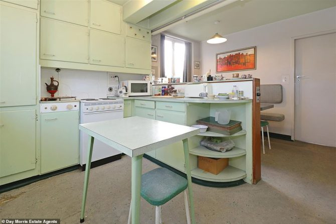 The kitchen has not changed since it was built in the years following the end of World War Two. A screen pulls down to separate the kitchen and eating areas as the current owner's mother did not like her family watching her cook