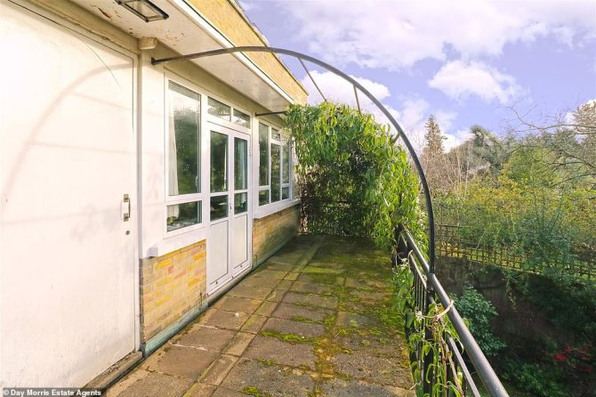 A large balcony leads from the living room and occupants of the house can look out on to the modest sized grassy garden below. A future owner could knock the existing building down and extend the house further on to this land
