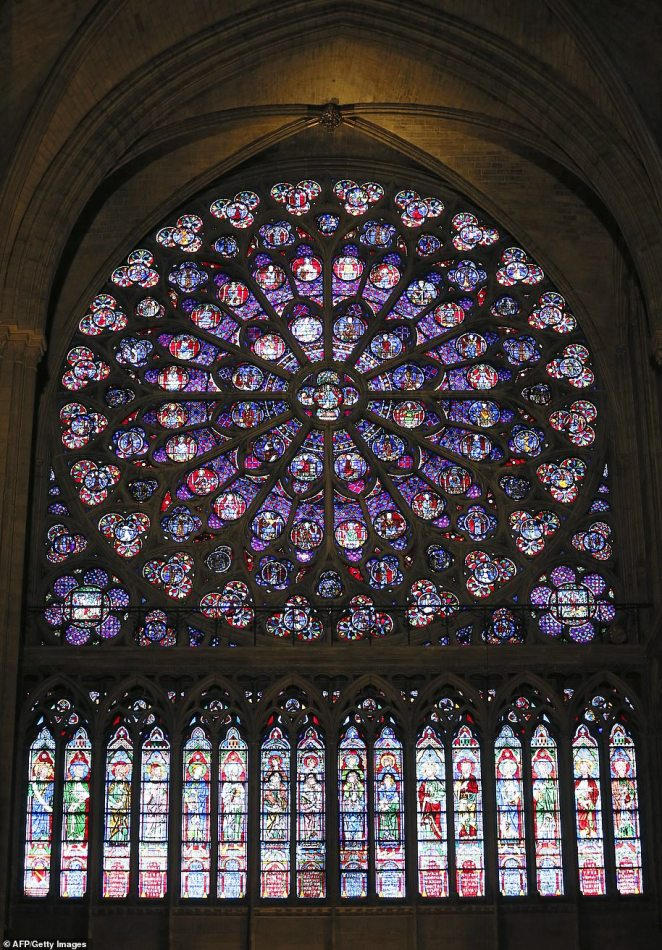 A view of the middle-age stained glass rosace on the southern side of the Notre-Dame de Paris cathedral
