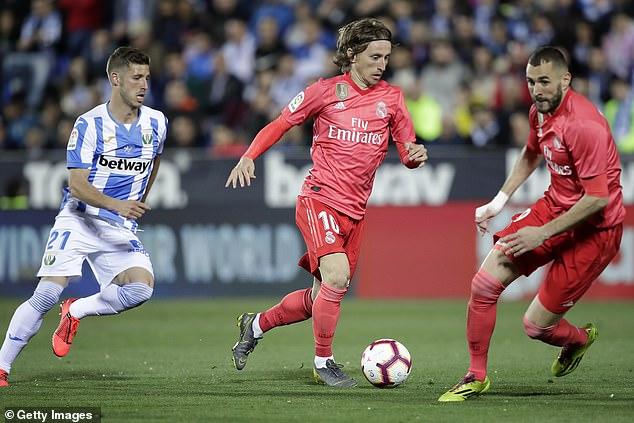 Ballon d'Or winner Luka Modric embarks on a driving run during the second half
