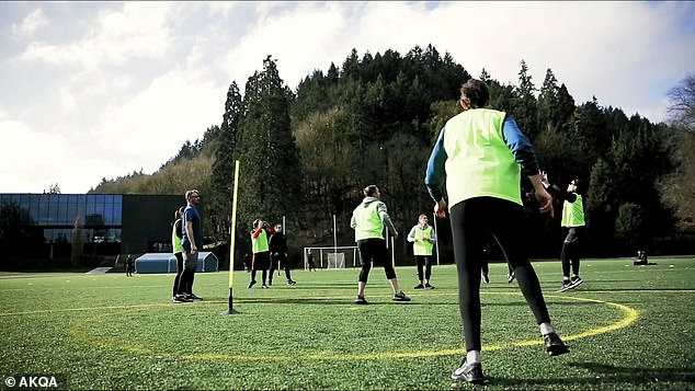 Players work in teams to pass a rugby training ball through three 'gates.'