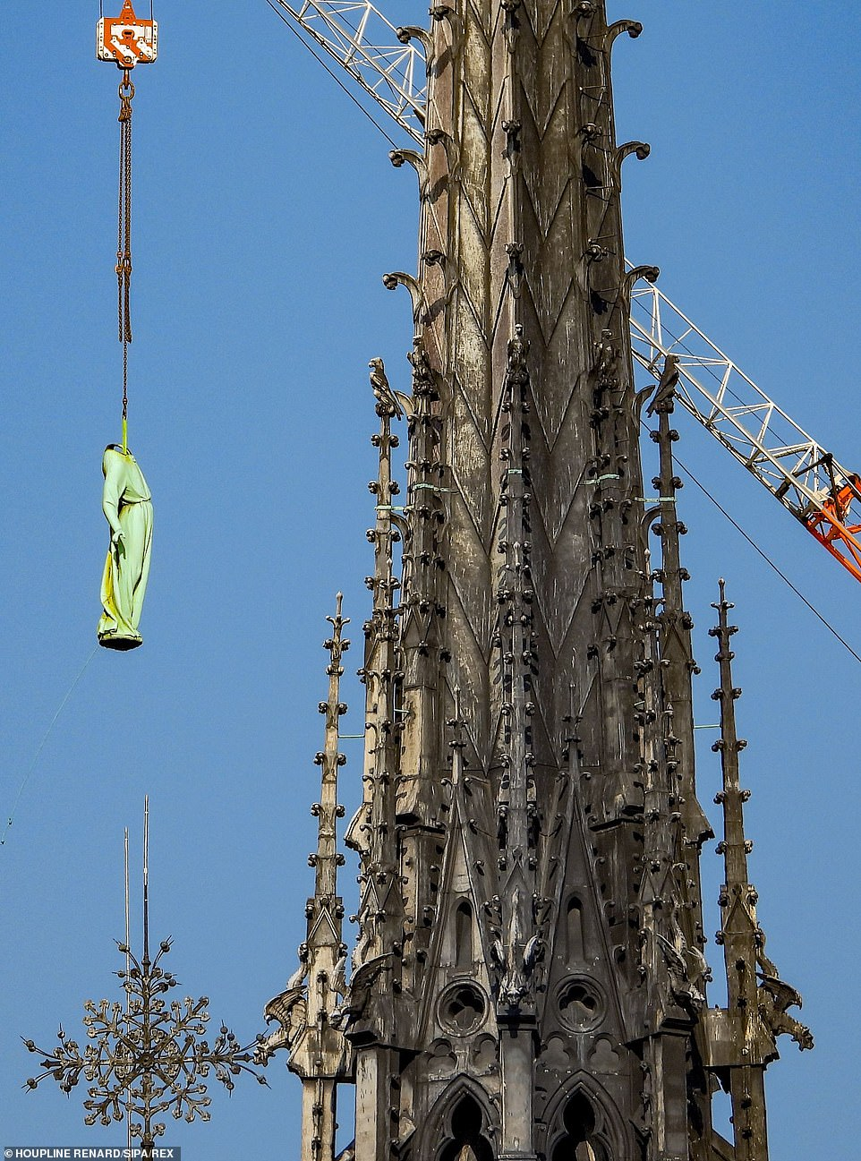 Last month cranes lifted the massive copper statues from their positions on the cathedral walls