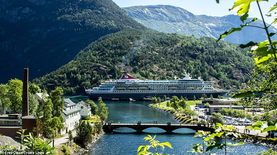 A shadow is cast on the small village of Hellsytt in Norway as the Balmoral ship fromFred Olsen Cruise Lines sails by. The vessel is the largest of the company's ocean-going cruise ships, yet still small enough to navigate size-restricted waterways such as the Norwegian fjords. It can hold1,325 passengers and 510 crew members and it boasts six restaurants