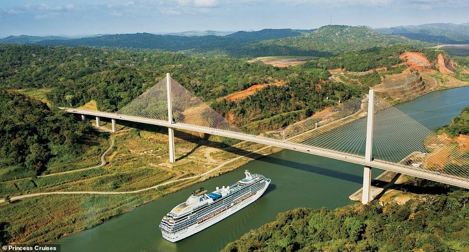 A Princess Cruises ship sails down the Panama Canal, past a spread of tree-lined hills and under theCentennial Bridge, which opened in 2004 and has a clearance of262 feet.The Panama Canal, which runs for 48 miles, is one of the Seven Wonders of the Modern World. Construction on the waterway was started by the French in 1881 but swiftly stopped after engineering problems and disease swept the area. The U.S. took over the project in 1904 and the canal opened on August 15, 1914