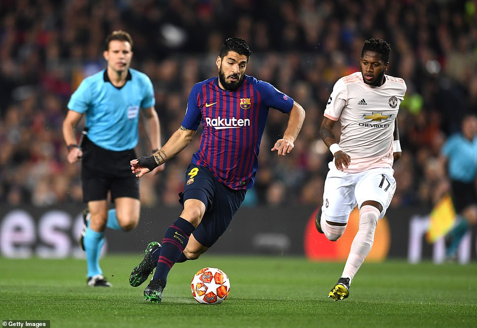 Luis Suarez bursts past United's Brazilian midfielder Fred during the opening stages of the second leg at the Nou Camp