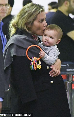 How sweet! Cheyenne, who appeared to go makeup free for her flight, kissed her baby's forehead at one stage as they waited at the check-in desk