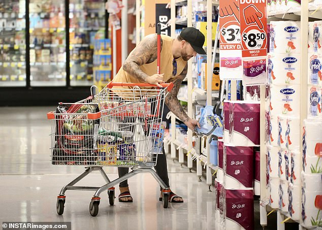 Cleaning items: Dan finished off his shopping trip by picking up a few cleaning products - including a mop and bucket